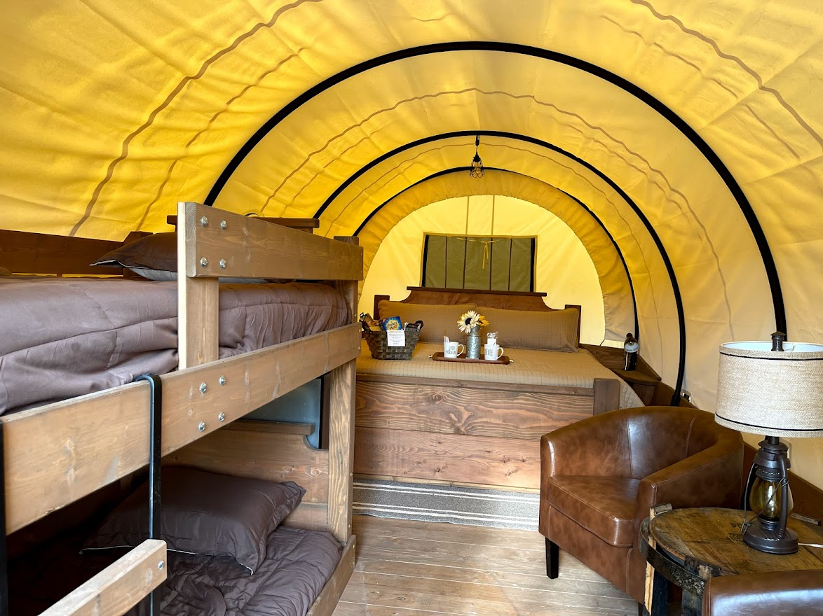 Horse Cave KOA covered wagon 2021-07 king size bed